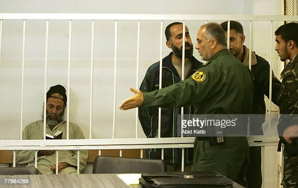 Sami Hamoda talks to the head of the military court Amen Nofal next to Yasser Zanon and Hani Mousa in the military court November 19 2007 in Gaza...