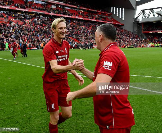 Sami Hyypia and John Aldridge of Liverpool FC Legends showing his appreciation to the fans at the end of the friendly match between Liverpool FC...