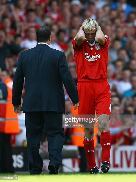 Sami Hyypia of Liverpool gets emotional after playing his last game for Liverpool as Rafael Benitez the manager looks on after the Barclays Premier...