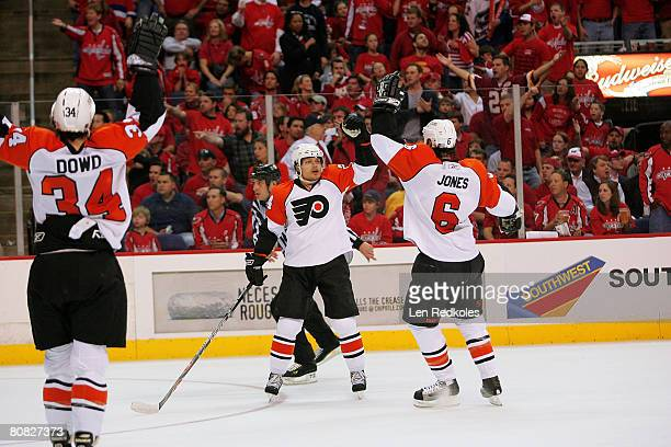Sami Kapanen celebrates his 2nd period goal with teammates Randy Jones and Jim Dowd of the Philadelphia Flyers against the Washington Capitals during...