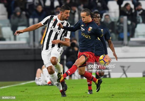 Sami Kedira of Juventus competes for the ball whit Diego Sebastian Suarez Laxalt of Genoa CFC during the Serie A match between Juventus and Genoa CFC...
