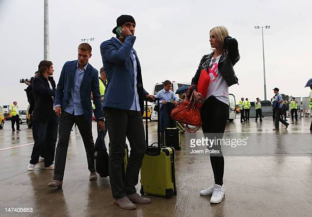 Sami Khedira and and his girlfriend Lena Gercke of Germany arrive at Frankfurt Airport following Germany's defeat to Italy in the semifinal of the...