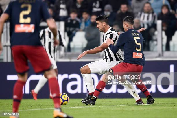 Sami Khedira and Armando Izzo during the Serie A match between Juventus and Genoa CFC on January 22 2018 in Turin Italy
