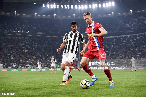 Sami Khedira and Bartosz Salamon during the Serie A match between Juventus and Spal at the Allianz Stadium on October 25 2017 in Turin Italy