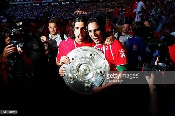Sami Khedira and Fernando Meira of Stuttgart celebrate with the German championship trophy after the Bundesliga match between VfB Stuttgart and...