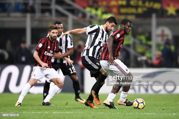 Sami Khedira and Franck Kessie during the Serie A match between AC Milan and Juventus at Stadio Giuseppe Meazza on October 28 2017 in Milan Italy