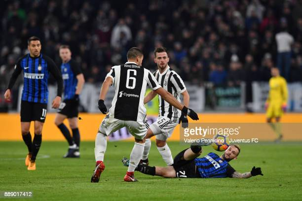 Sami Khedira and Miralem Pjanic of Juventus compete for the ball with Marcelo Brozovic of FC Internazionale during the Serie A match between Juventus...