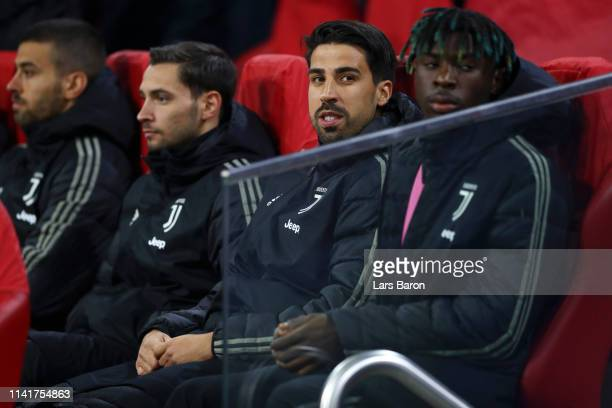 Sami Khedira and Moise Kean sit on the bench during the UEFA Champions League Quarter Final first leg match between Ajax and Juventus at Johan Cruyff...