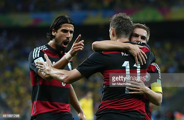 Sami Khedira and Philipp Lahm of Germany congratulate Miroslav Klose on his goal during the 2014 FIFA World Cup Brazil Semi Final match between...