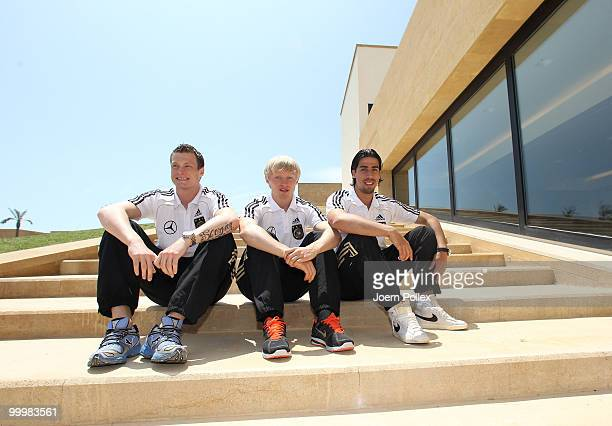 Sami Khedira Andreas Beck and Marcell Jansen of Germany are pictured during a press conference at Verdura Golf and Spa Resort on May 19 2010 in...