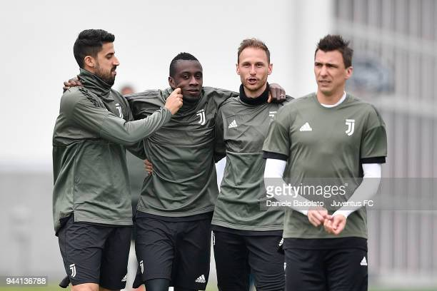 Sami Khedira Blaise Matuidi and Benedikt Howedes in action during the Champions League training session at Juventus Center Vinovo on April 10 2018 in...