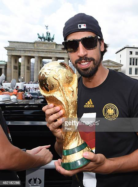 Sami Khedira celebrates on the open top bus at the German team victory ceremony on July 15 2014 in Berlin Germany Germany won the 2014 FIFA World Cup...
