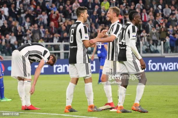 Sami Khedira celebrates with Benedikt Hwedes after scoring with teammates during the Serie A football match between Juventus FC and US Sampdoria at...