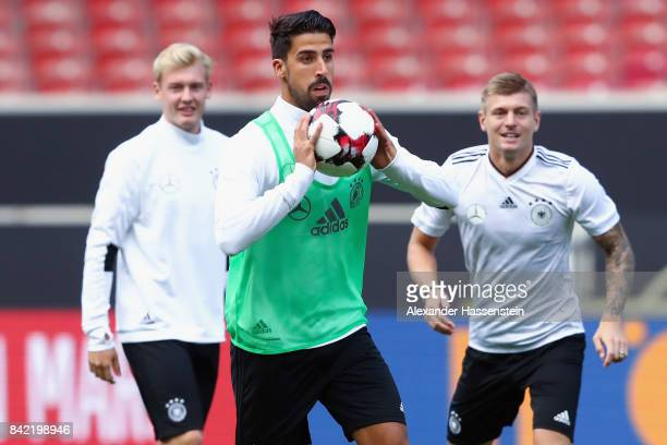 Sami Khedira holds the ball during a Germany training session at MercedesBenzArena ahead of their FIFA World Cup Russia 2018 Group C Qualifier...