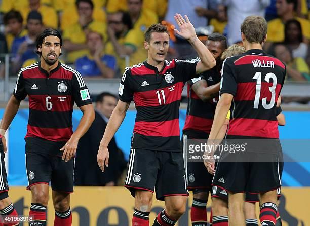 Sami Khedira Miroslav Klose Thomas Mueller of Germany celebrate a goal during the 2014 FIFA World Cup Brazil Semi Final match between Brazil and...