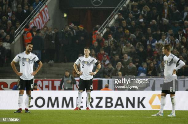 Sami Khedira Niklas Sule and Toni Kroos of Germany react during the international friendly soccer match between Germany and France at RheinEnergie...