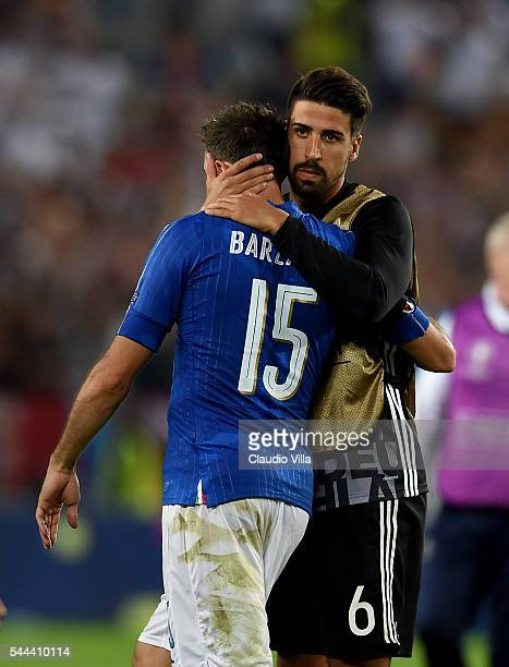 Sami Khedira of Germany and Andrea Barzagli of Italy at the end of the UEFA Euro 2016 quarter final match between Germany and Italy at Stade Matmut...