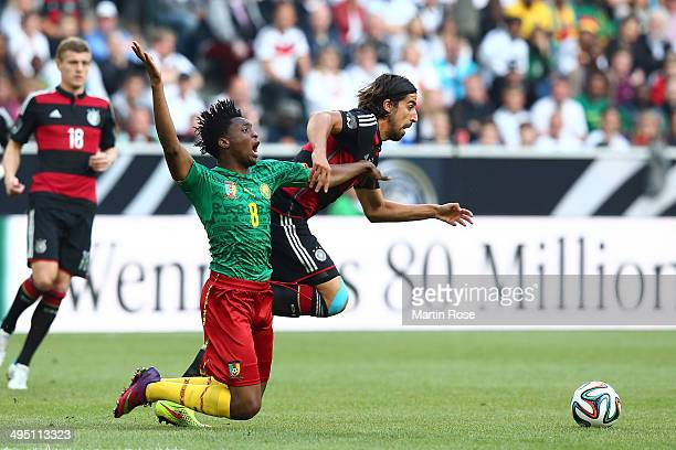 Sami Khedira of Germany and Benjamin Moukandji of Cameroon battle for the ball during the International Friendly Match between Germany and Cameroon...