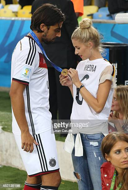Sami Khedira of Germany and his girlfriend Lena Gercke celebrate the victory after the 2014 FIFA World Cup Brazil Final match between Germany and...