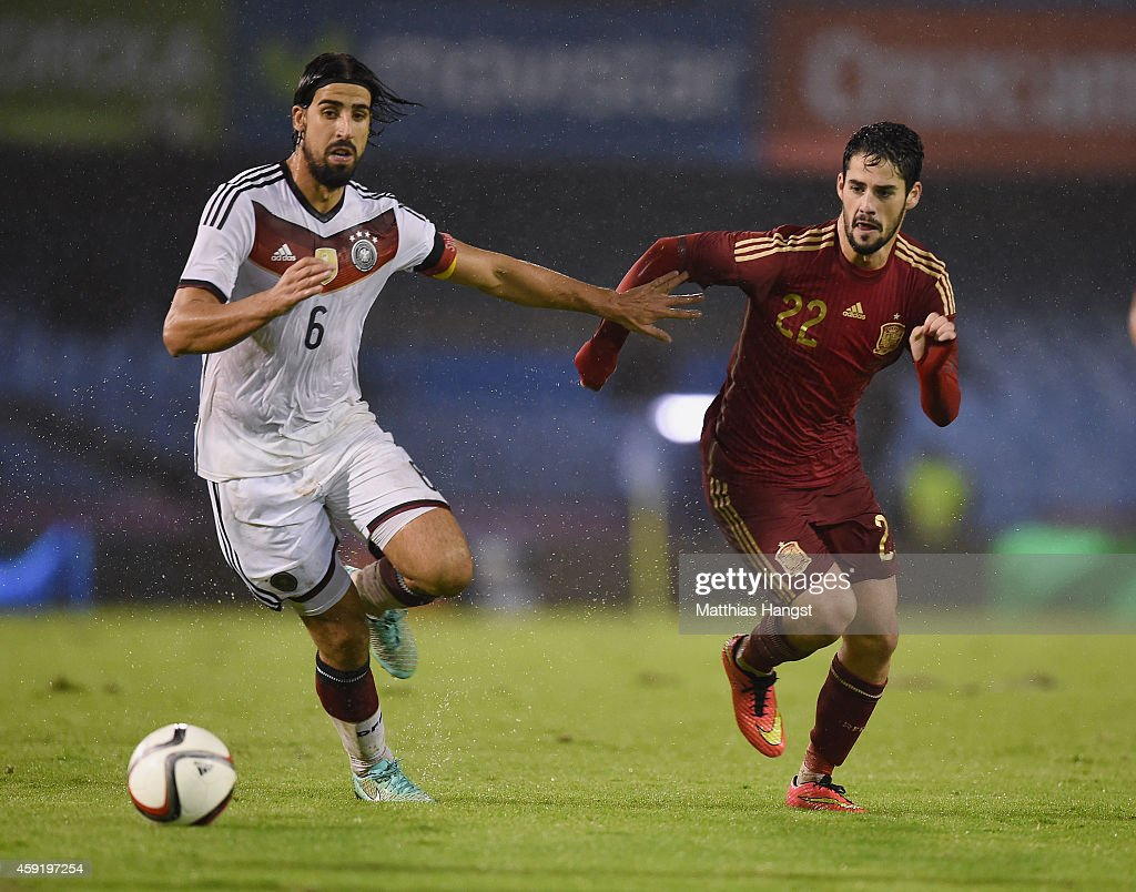 Sami Khedira (L) of Germany and Isco (R) of Spain compete for the ball during the International Friendly match between Spain and Germany at Estadio Balaidos on November 18, 2014 in Vigo, Spain.