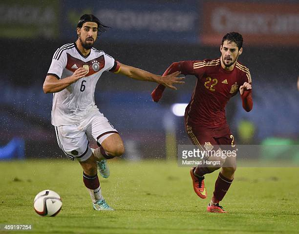 Sami Khedira of Germany and Isco of Spain compete for the ball during the International Friendly match between Spain and Germany at Estadio Balaidos...