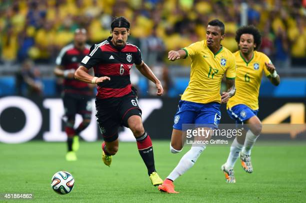 Sami Khedira of Germany and Luiz Gustavo of Brazil compete for the ball during the 2014 FIFA World Cup Brazil Semi Final match between Brazil and...
