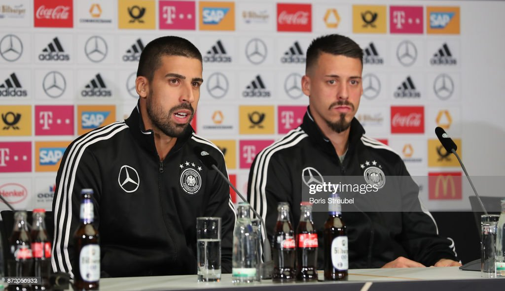 Sami Khedira of Germany and Sandro Wagner of Germany look on during a press conference ahead of a international friendly match against England at Mercedes Benz am Salzufer on November 9, 2017 in Berlin, Germany.