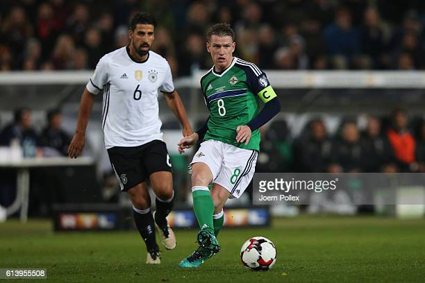 Sami Khedira of Germany and Steven Davis of Northern Ireland compete for the ball during the FIFA 2018 World Cup Qualifier between Germany and...