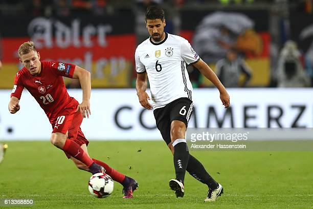 Sami Khedira of Germany battles for the ball with Matej Vydra of Czech Republic during the 2018 FIFA World Cup Qualifier match between Germany and...