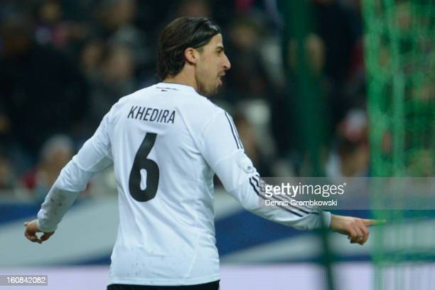 Sami Khedira of Germany celebrates after scoring his team's second goal during the international friendly match between France and Germany at Stade...