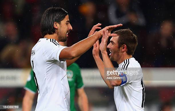 Sami Khedira of Germany celebrates his team's first goal with team mate Philipp Lahm during the FIFA 2014 World Cup Group C qualifiying match between...