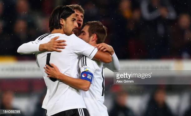 Sami Khedira of Germany celebrates his team's first goal with team mates Thomas Mueller and Philipp Lahm during the FIFA 2014 World Cup Group C...