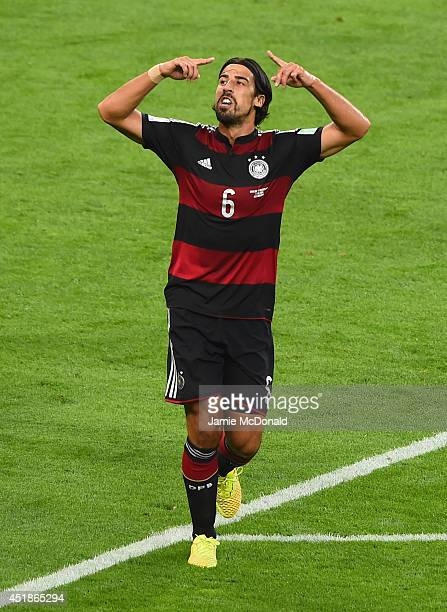Sami Khedira of Germany celebrates scoring his team's fifth goal during the 2014 FIFA World Cup Brazil Semi Final match between Brazil and Germany at...