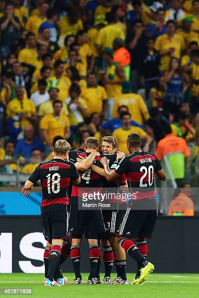Sami Khedira of Germany celebrates scoring his team's fifth goal with teammates Toni Kroos Benedikt Hoewedes Thomas Mueller and Jerome Boateng during...