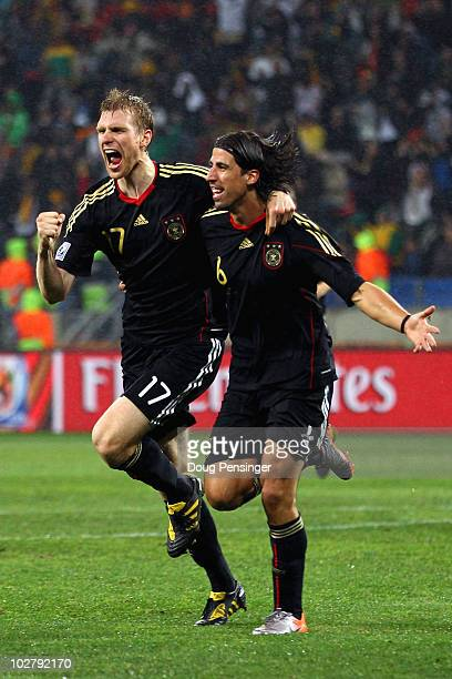 Sami Khedira of Germany celebrates scoring his team's third goal with Per Mertesacker during the 2010 FIFA World Cup South Africa Third Place...