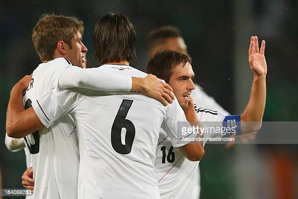 Sami Khedira of Germany celebrates scoring the opening goal with his team mates Thomas Mueller and Philipp Lahm during the FIFA 2014 World Cup...