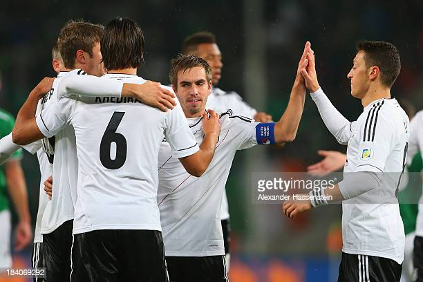 Sami Khedira of Germany celebrates scoring the opening goal with his team mates Thomas Mueller Philipp Lahm and Mesut Oezil during the FIFA 2014...