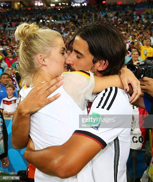 Sami Khedira of Germany celebrates with girlfriend Lena Gercke after defeating Argentina 10 in extra time during the 2014 FIFA World Cup Brazil Final...