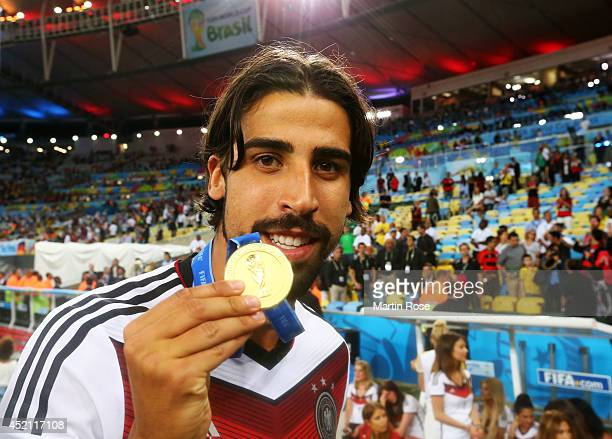 Sami Khedira of Germany celebrates with his medal after defeating Argentina 10 in extratime during the 2014 FIFA World Cup Brazil Final match between...
