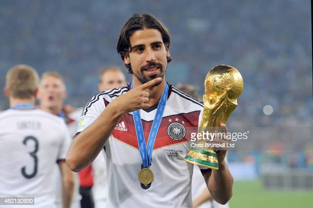 Sami Khedira of Germany celebrates with the trophy following the 2014 World Cup Final match between Germany and Argentina at Maracana Stadium on July...
