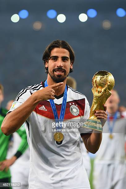 Sami Khedira of Germany celebrates with the World Cup trophy after defeating Argentina 10 in extra time during the 2014 FIFA World Cup Brazil Final...
