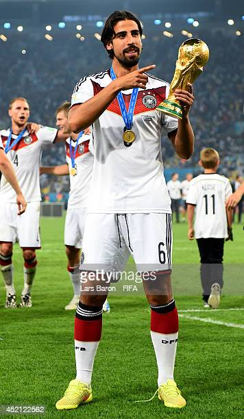 Sami Khedira of Germany holds up the World Cup torphy after the 2014 FIFA World Cup Brazil Final match between Germany and Argentina at Maracana on...