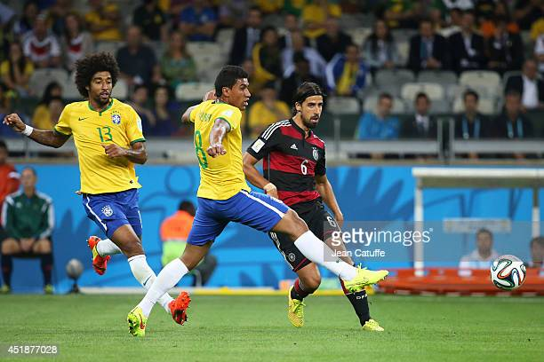Sami Khedira of Germany in action as Paulinho of Brazil looks on during the 2014 FIFA World Cup Brazil Semi Final match between Brazil and Germany at...