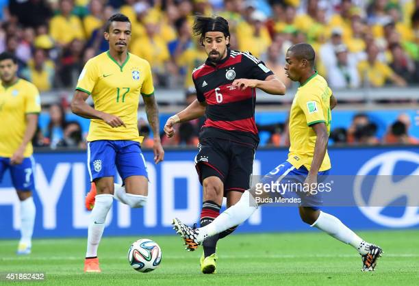 Sami Khedira of Germany is challenged by Fernandinho of Brazil during the 2014 FIFA World Cup Brazil Semi Final match between Brazil and Germany at...