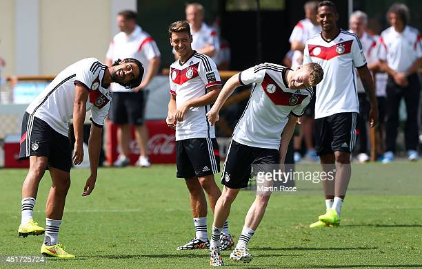 Sami Khedira of Germany jokes with team mate Andre Schuerrle during the German national team training at Campo Bahia on July 5 2014 in Santo Andre...