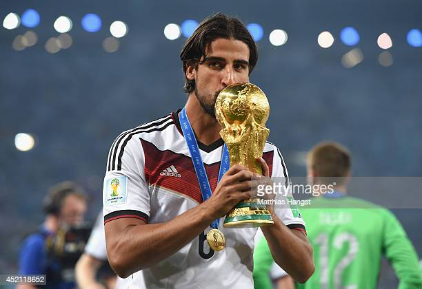 Sami Khedira of Germany kisses the World Cup trophy after defeating Argentina 10 in extra time during the 2014 FIFA World Cup Brazil Final match...