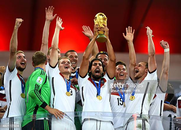 Sami Khedira of Germany lifts the World Cup to celebrate with his teammates during the award ceremony after the 2014 FIFA World Cup Brazil Final...
