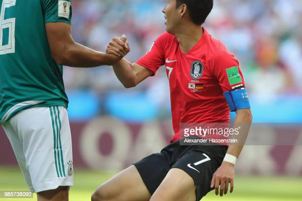 Sami Khedira of Germany performes fair play with Wooyoung Jung of Korea Republic during the 2018 FIFA World Cup Russia group F match between Korea...