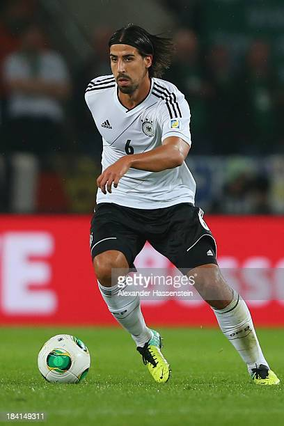 Sami Khedira of Germany runs with the ball during the FIFA 2014 World Cup Qualifier Group C match between Germany and Republic of Ireland at...