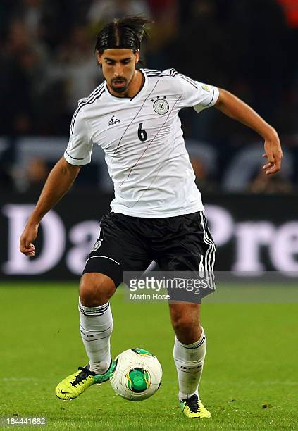 Sami Khedira of Germany runs with the ball during the FIFA 2014 World Cup Qualifier group C match between Germany and Ireland at RheinEnergieStadion...